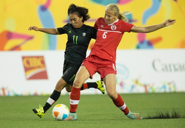 Canada's Rebecca Quinn (6) and Mexico's Monica Ocampo (11) fight for ball posession during the first half of the 2015 Pan Am Games women's bronze medal soccer match in Hamilton, Ontario on Friday, July 24, 2015. THE CANADIAN PRESS/Peter Power
