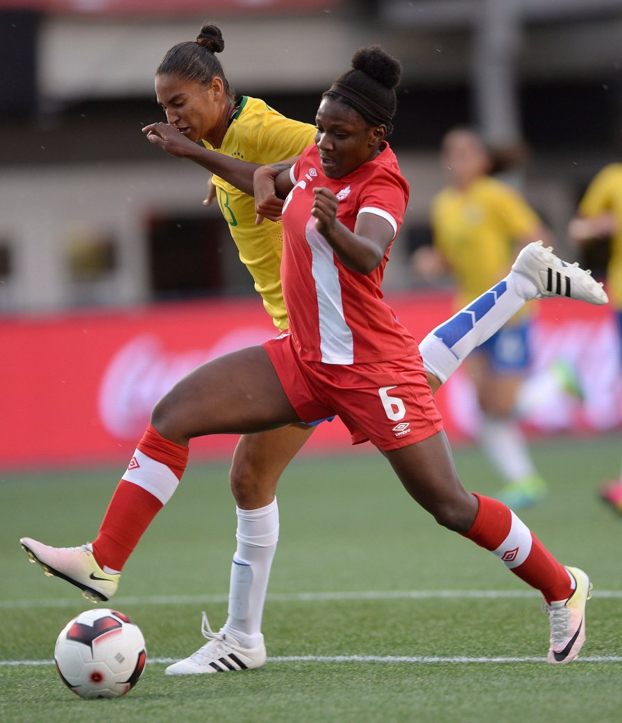 Canada's Deanne Rose (6) moves the ball past Brazil's Poliana during first half international women's friendly soccer action in Ottawa on Tuesday, June 7, 2016. THE CANADIAN PRESS/Sean Kilpatrick