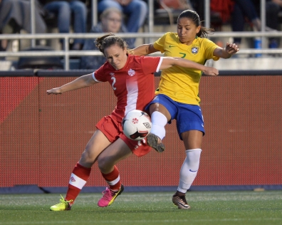 Canada's Allysha Chapman (2) fights for the ball against Brazil's Debinha during second half international women's soccer friendly action in Ottawa on Tuesday, June 7, 2016. THE CANADIAN PRESS/Sean Kilpatrick