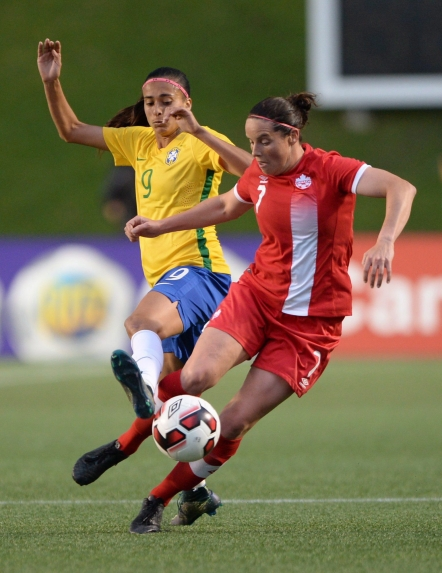 Canada's Rhian Wilkinson (7) moves the ball away from Brazil's A. Alves during second half international women's soccer friendly action in Ottawa on Tuesday, June 7, 2016. THE CANADIAN PRESS/Sean Kilpatrick