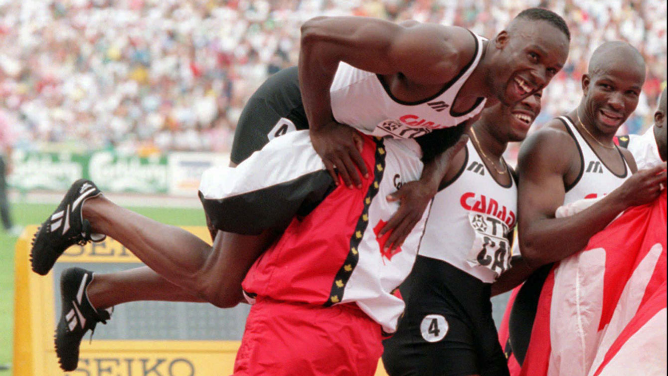 Bruny Surin (left) and Donovan Bailey (right) went 1-2 in Gothenburg 1995, and later (pictured here) celebrated winning relay gold with Glenroy Gilbert and Robert Esmie at the IAAF World Championships in Sweden.