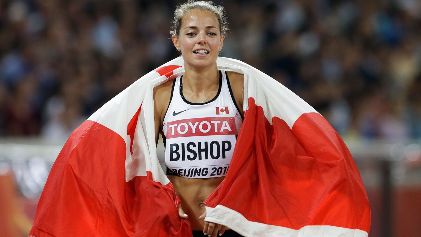Melissa Bishop celebrates with the flag after winning 800m silver at the world championships in Beijing on August 29, 2015.