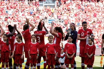 Canadian team salutes the crowd following the national anthem in Toronto
