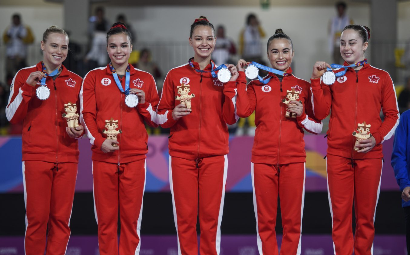 Canadian artistic gymnastics team members on podium