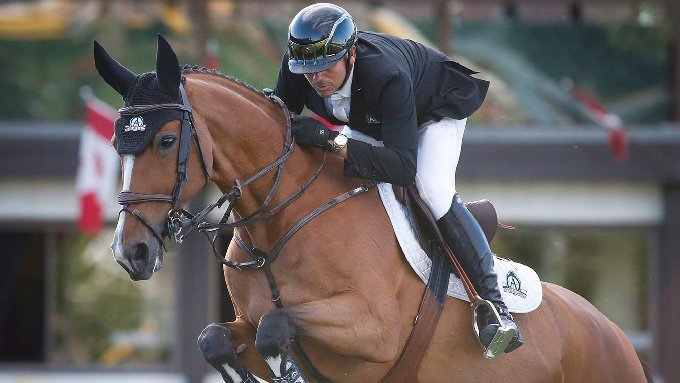 Eric Lamaze and Fine Lady 5 compete at Spruce Meadows in Calgary on June 9, 2016. (Jeff McIntosh)