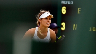 Eugenie Bouchard of Canada waits to receive a serve from Magdalena Rybarikova of Slovakia during their women's singles match on day two of the Wimbledon Tennis Championships in London, Tuesday, June 28, 2016. (AP Photo/Alastair Grant)