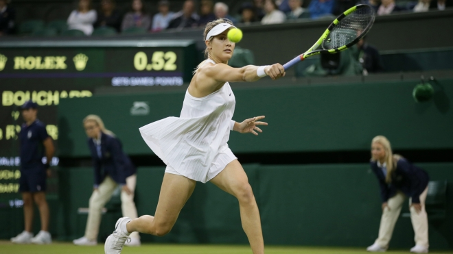 Eugenie Bouchard of Canada plays a return to Magdalena Rybarikova of Slovakia during their women's singles match on day three of the Wimbledon Tennis Championships in London, Wednesday, June 29, 2016. (AP Photo/Tim Ireland)