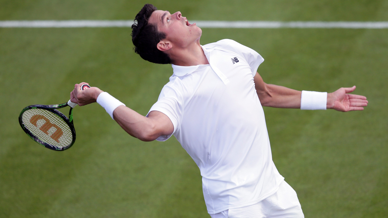 Milos Raonic of Canada serves to Pablo Carreno Busta of Spain during their men's singles match on day one of the Wimbledon Tennis Championships in London, Monday, June 27, 2016. (AP Photo/Tim Ireland)