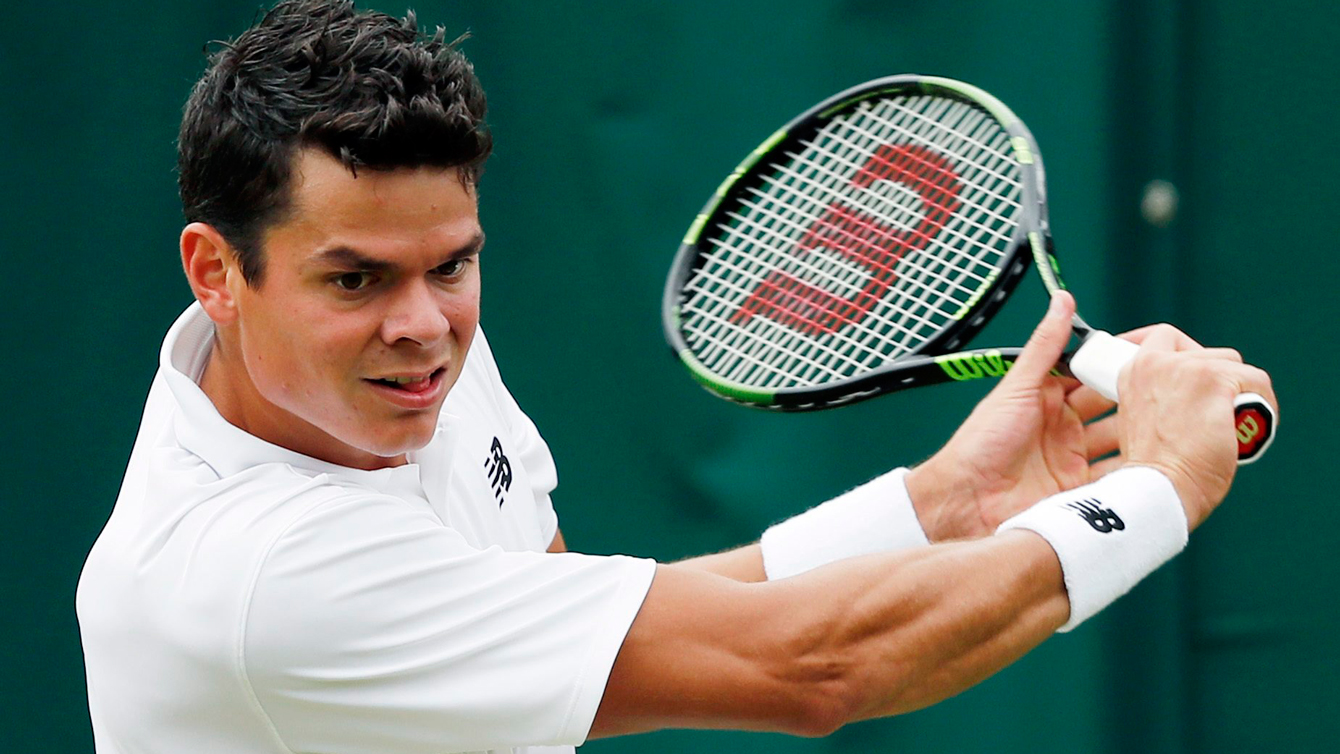 Milos Raonic of Canada returns to Andreas Seppi of Italy during their men's singles match on day four of the Wimbledon Tennis Championships in London, Thursday, June 30, 2016. (AP Photo/Ben Curtis)