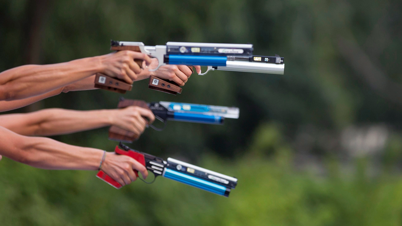 Shooting and running are combined in modern pentathlon. (AP Photo/Axel Schmidt)
