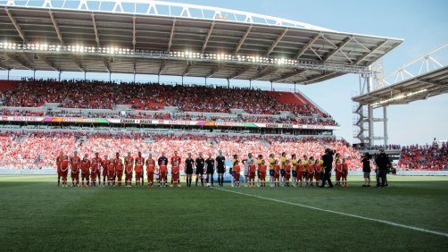 Canada (in red) and Brazil line up ahead of their international friendly