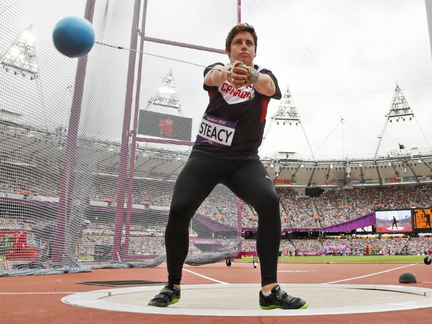 Canada's Heather Steacy competes in a women's hammer throw qualification round during the athletics in the Olympic Stadium at the 2012 Summer Olympics, London, Wednesday, Aug. 8, 2012. (AP Photo/Matt Dunham)