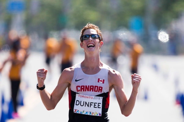 Canada's Evan Dunfee reacts as he crosses the finish to win the men's 20km race walk at the Pan Am Games in Toronto, Ontario, Sunday, July 19, 2015. (AP Photo/Felipe Dana)