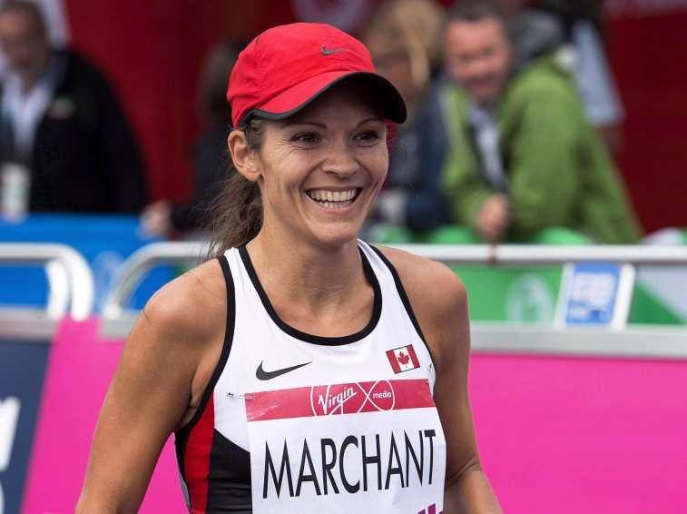 Canada's Lanni Marchant smiles after racing to a fourth place finish in the women's marathon at the Commonwealth Games in Glasgow, Scotland on Sunday, July 27, 2014. THE CANADIAN PRESS/Andrew Vaughan