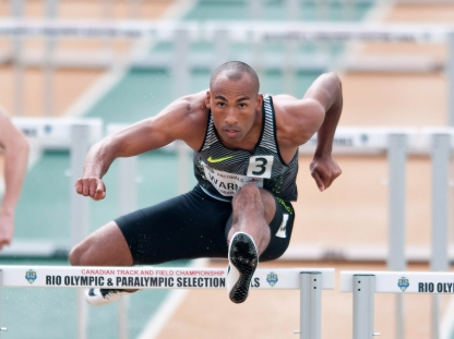 Damian Warner competes a heat of the senior men 110m hurdles during the Canadian Track and Field Championships and Selection Trials for the 2016 Summer Olympic and Paralympic Games, in Edmonton, Alta., on Sunday July 10, 2016. THE CANADIAN PRESS/Dan Riedlhuber