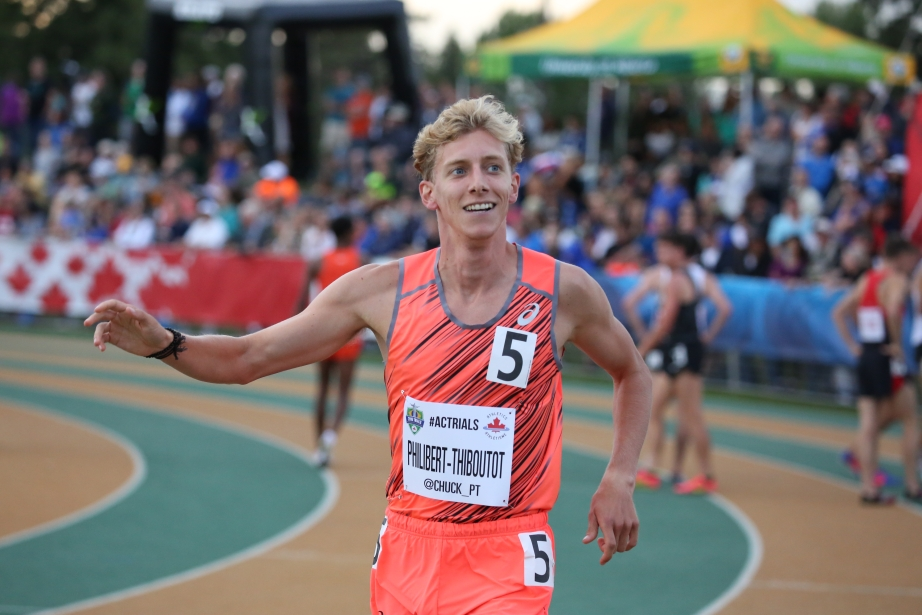 Charles Philibert-Thiboutot celebrating after realizing he is going to Rio for the 1500m at the Canadian Track and Field Championships and Selection Trials for the 2016 Summer Olympic and Paralympic Games, in Edmonton, Alta. (Steve Boudraeu/COC)