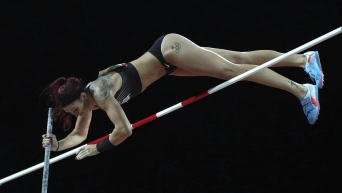 Pole vaulter going over bar