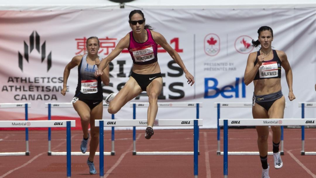Runner going over hurdles