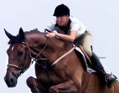 Millar on a horse competing
