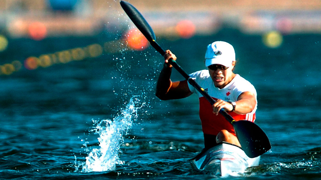 Canada's Caroline Brunet sits in her boat after crossing the finish line to win a bronze medal in the K1 500meter final at the Summer Olympics in Schinias, Greece, Saturday, August 28, 2004.