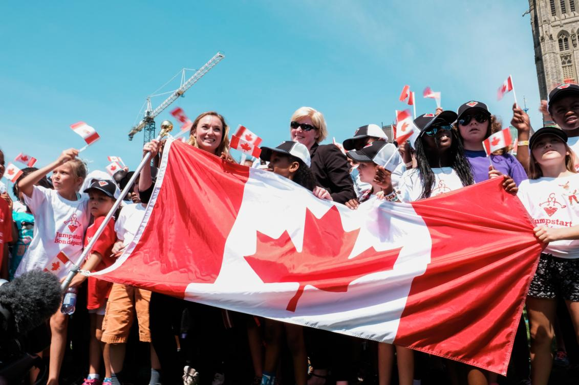 Rosie MacLennan holding the Canadian Flag after being named Canada's flag bearer for Rio 2016. July 21, 2016 in Ottawa. (Thomas Skrlj/COC)