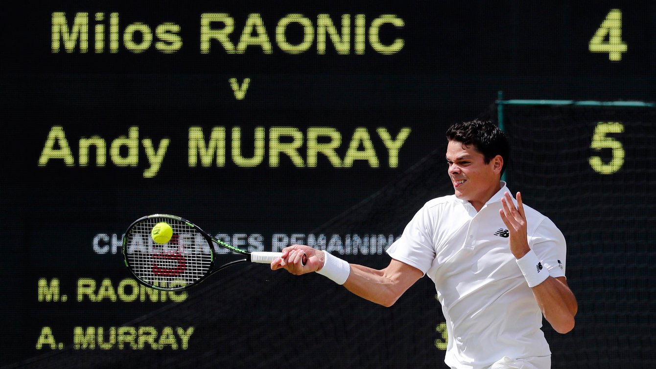 Milos Raonic of Canada hits a return to Andy Murray of Britain during the men's singles final on the fourteenth day of the Wimbledon Tennis Championships in London, Sunday, July 10, 2016. (AP Photo/Ben Curtis)