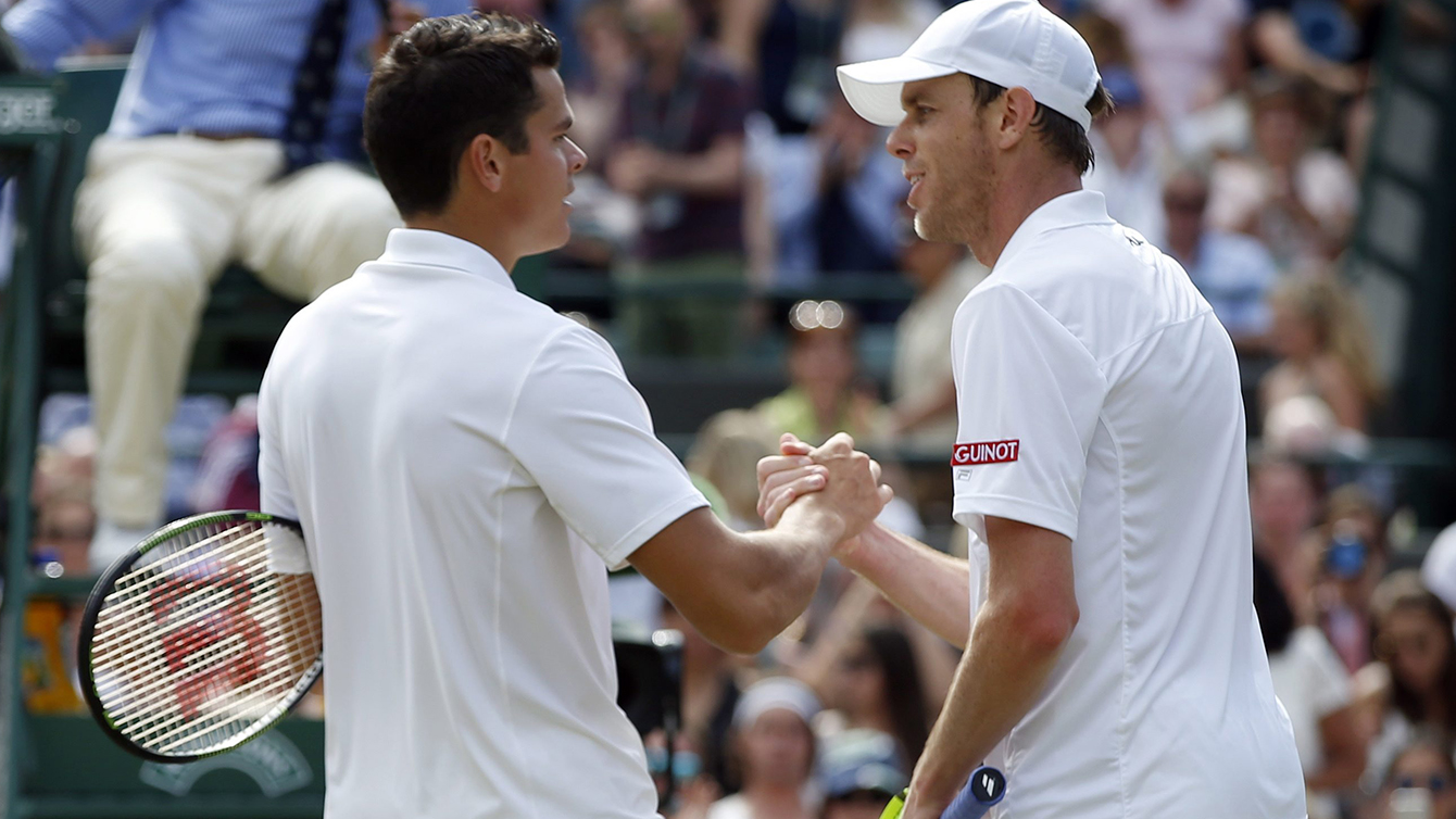 Milos Raonic of Canada, left, shakes hands at match point after beating Sam Querrey of the U.S in their men's singles match on day ten of the Wimbledon Tennis Championships in London, Wednesday, July 6, 2016. (AP Photo/Alastair Grant)