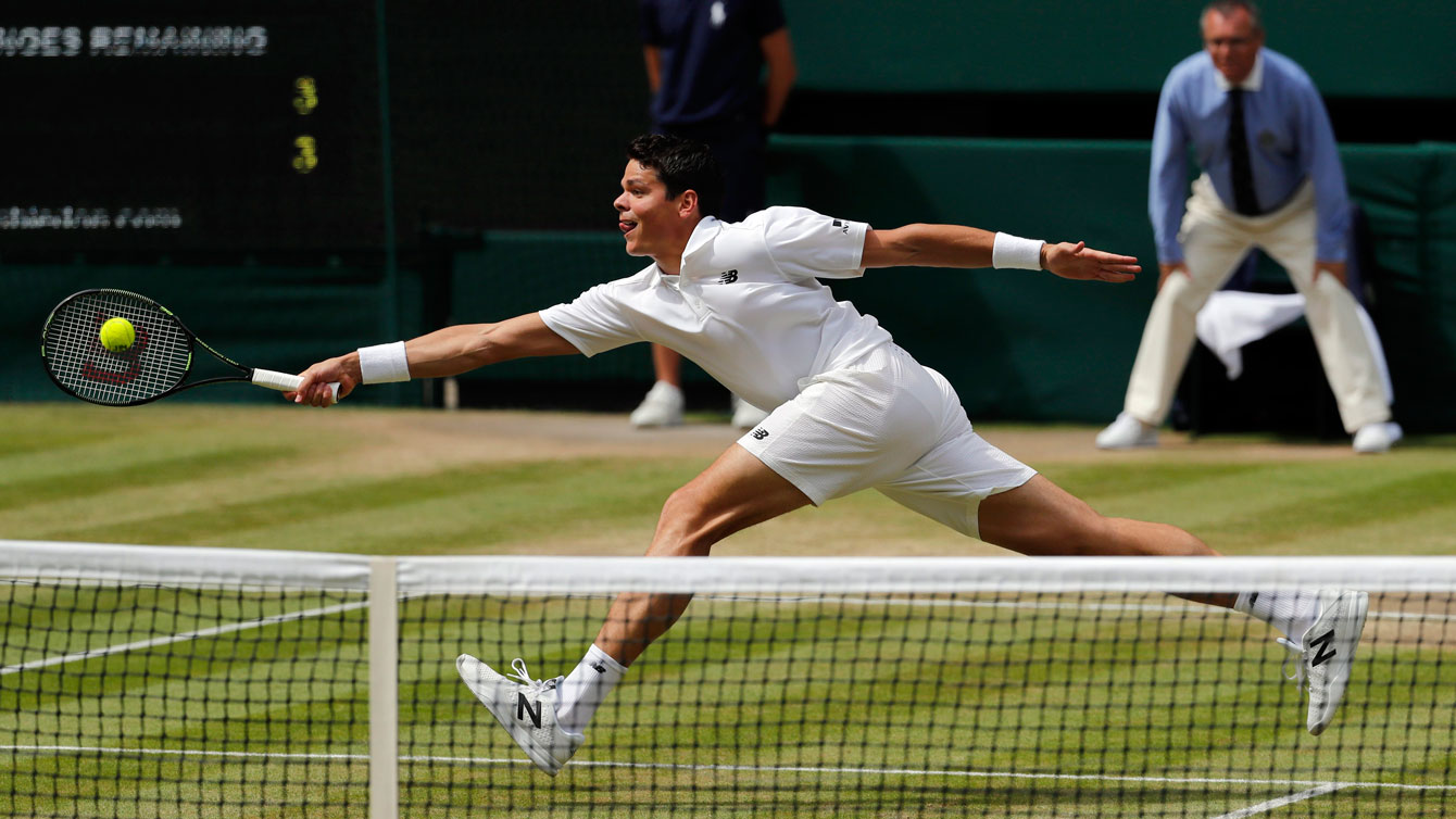 Milos Raonic reaches for the ball against Andy Murray at Wimbledon final on July 10, 2016.