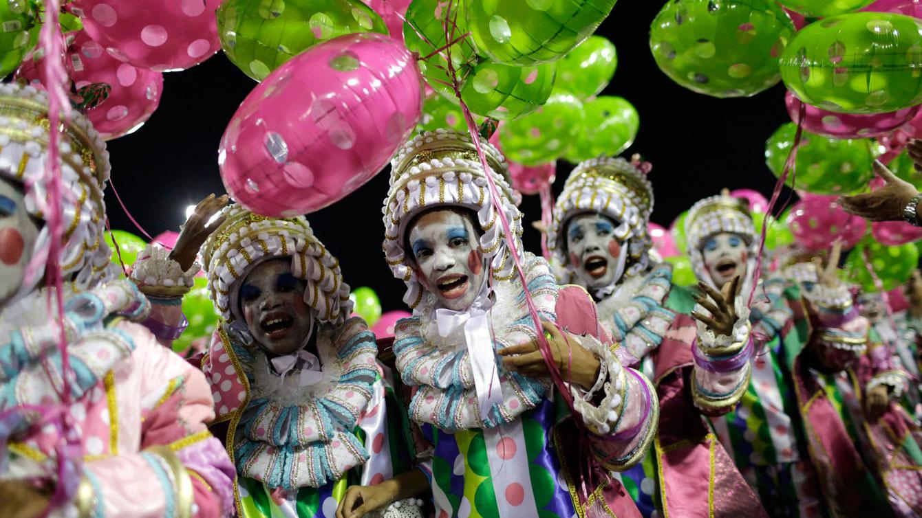 Performers from the Mangueira samba school parade during carnival celebrations at the Sambadrome in Rio de Janeiro, Brazil, 2016. (AP Photo/Leo Correa)