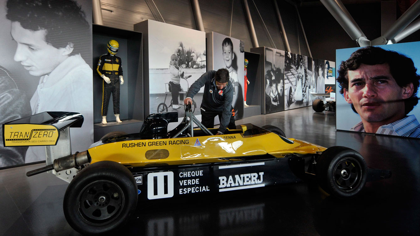 A caretaker tends to Ayrton Senna's 1983 race car on April 30, 2014 ahead of a gathering at the Imola track in Italy to commemorate the 20th anniversary of Senna's death.