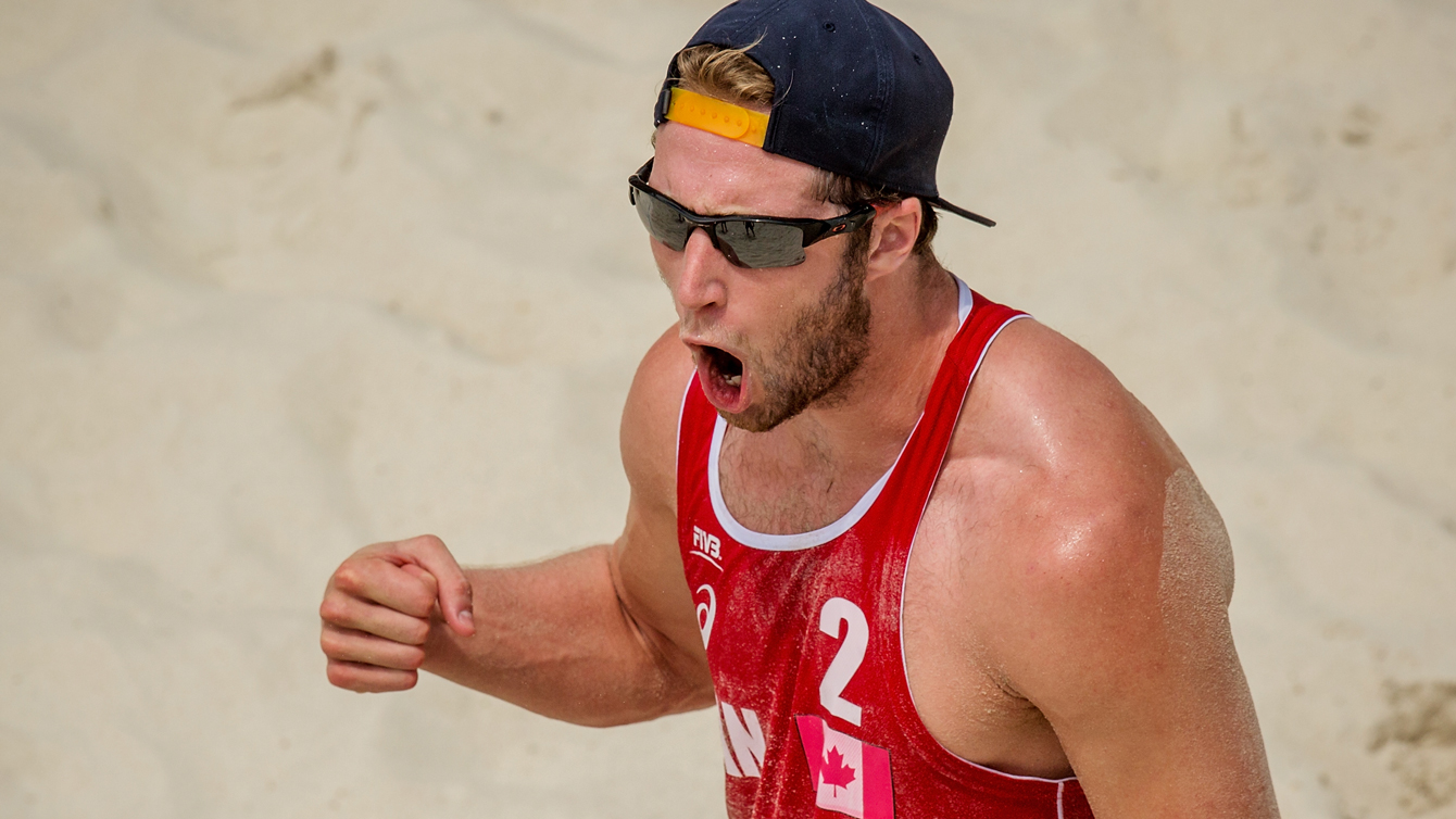 Sam Schachter of Canada celebrates a point at the Olympic qualification tournament in Sochi. (Photo: FIVB)