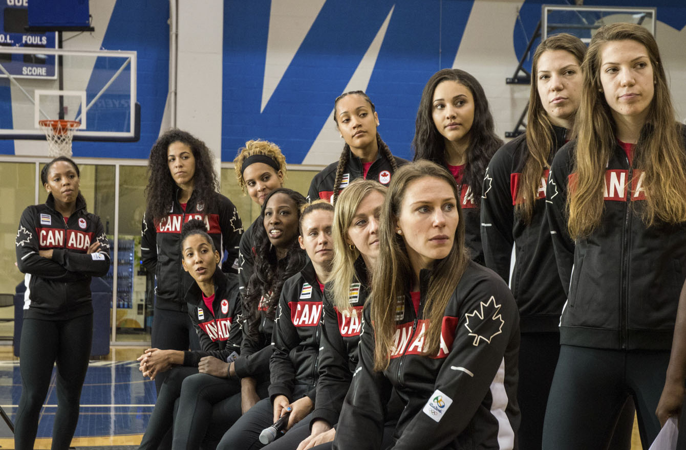 Members of the Canadian Olympic women's basketball team watch a video at Toronto's Mattamy Athletic Centre on July 22, 2016. (Tavia Bakowski/COC)