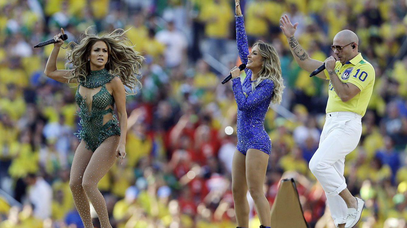 US singer Jennifer Lopez, left, rapper Pitbull and Brazilian singer Claudia Leitte perform during the opening ceremony ahead of the group A World Cup soccer match between Brazil and Croatia, the opening game of the tournament, in the Itaquerao Stadium in Sao Paulo, Brazil, Thursday, June 12, 2014. (AP Photo/Kirsty Wigglesworth)