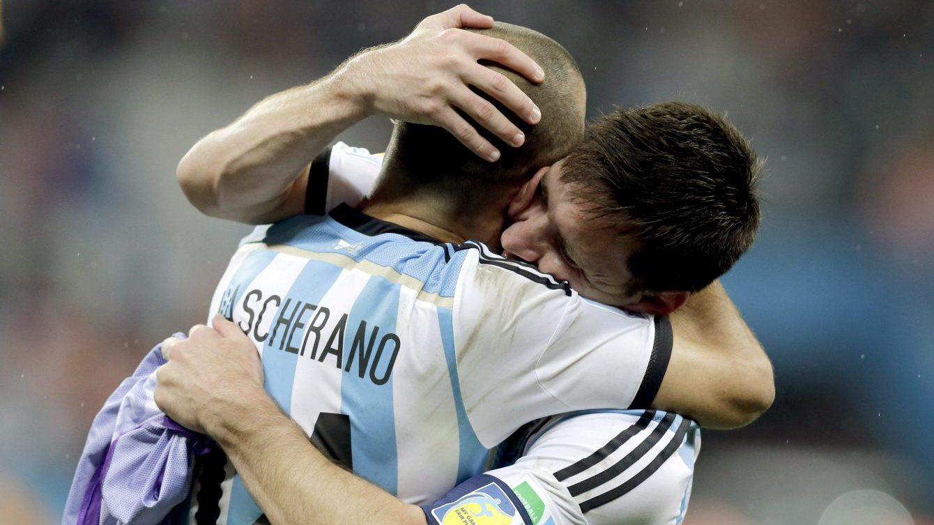 FILE - In this July 9, 2014, file photo, Argentina's Lionel Messi, right, hugs Javier Mascherano after Argentina defeated the Netherlands 4-2 in a penalty shootout after a 0-0 tie after extra time to advance to the finals during the World Cup semifinal soccer match between the Netherlands and Argentina at the Itaquerao Stadium in Sao Paulo Brazil. (AP Photo/Victor R. Caivano, File)