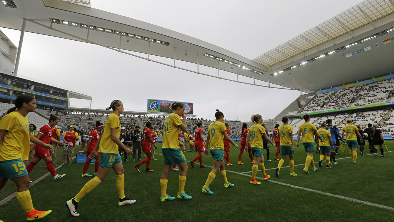 Australia, front row, and Canada team soccer players enter the field before their 2016 Summer Olympics football match at the Arena Corinthians in Sao Paulo, Brazil, Wednesday, Aug. 3, 2016. (AP Photo/Nelson Antoine)