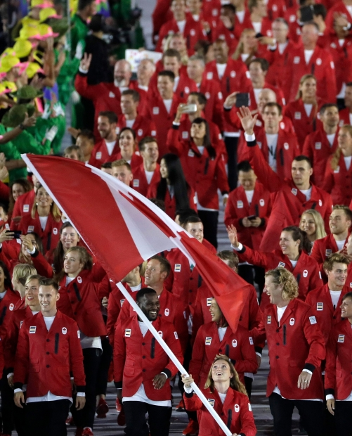 Rosannagh Maclennan carries the flag of Canada during the opening ceremony for the 2016 Summer Olympics in Rio de Janeiro, Brazil, Friday, Aug. 5, 2016. (AP Photo/Matt Slocum)