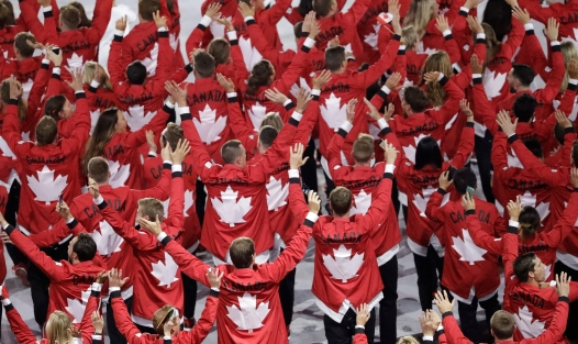 Team Canada wave as they walk into the stadium during the opening ceremony for the 2016 Summer Olympics in Rio de Janeiro, Brazil, Friday, Aug. 5, 2016. (AP Photo/Matthias Schrader)