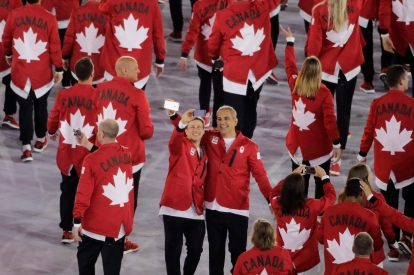 Members of team Canada take a selfie during the opening ceremony of the 2016 Summer Olympics in Rio de Janeiro, Brazil, Friday, Aug. 5, 2016. (AP Photo/Charlie Riedel)