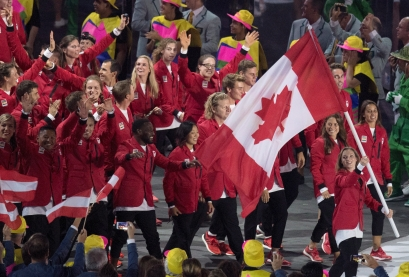 Rosie MacLennan carries the flag as she leads Canada into the opening ceremonies for the 2016 Summer Olympics Friday August 5, 2016 in Rio de Janeiro, Brazil. THE CANADIAN PRESS/Frank Gunn