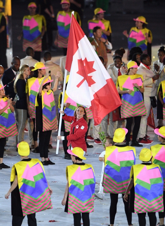 Rosie MacLennan leads team Canada into the stadium during the opening ceremonies at the 2016 Olympic Games in Rio de Janeiro, Brazil on Friday, Aug. 5, 2016. THE CANADIAN PRESS/Sean Kilpatrick