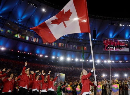 Rosannagh Maclennan carries the flag of Canada during the opening ceremony for the 2016 Summer Olympics in Rio de Janeiro, Brazil, Friday, Aug. 5, 2016. (AP Photo/David J. Phillip)