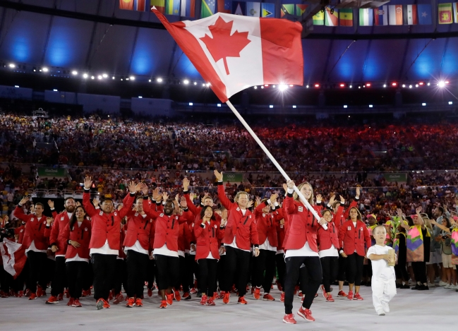 Rosie MacLennan carries Canadian flag at opening ceremony