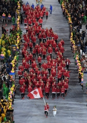 Rosannagh Maclennan carries the flag of Canada during the opening ceremony for the 2016 Summer Olympics in Rio de Janeiro, Brazil, Friday, Aug. 5, 2016. (Richard Heathcote/Pool Photo via AP)