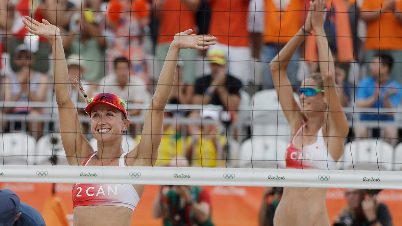 Heather Bansley and Sarah Pavan, Rio 2016. Aug. 7, 2016. AP Photo/Marcio Jose Sanchez