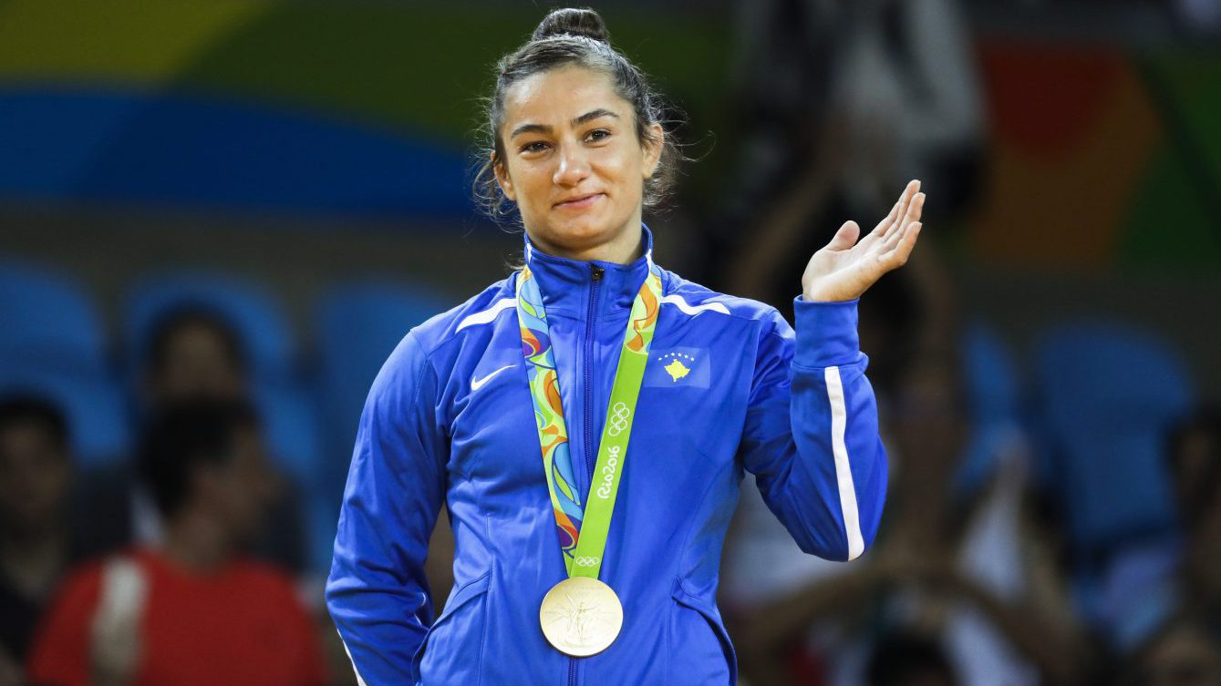 Kosovo's Majlinda Kelmendi receives the gold medal after winning the women's 52-kg judo competition at the 2016 Summer Olympics in Rio de Janeiro, Brazil, Sunday, Aug. 7, 2016. (AP Photo/Markus Schreiber)