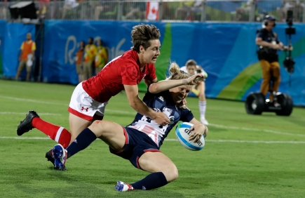 Great Britain's Danielle Waterman, right, scores a try as Canada's Ghislaine Landry, defends during the women's rugby sevens bronze medal match at the Summer Olympics in Rio de Janeiro, Brazil, Monday, Aug. 8, 2016. (AP Photo/Themba Hadebe)