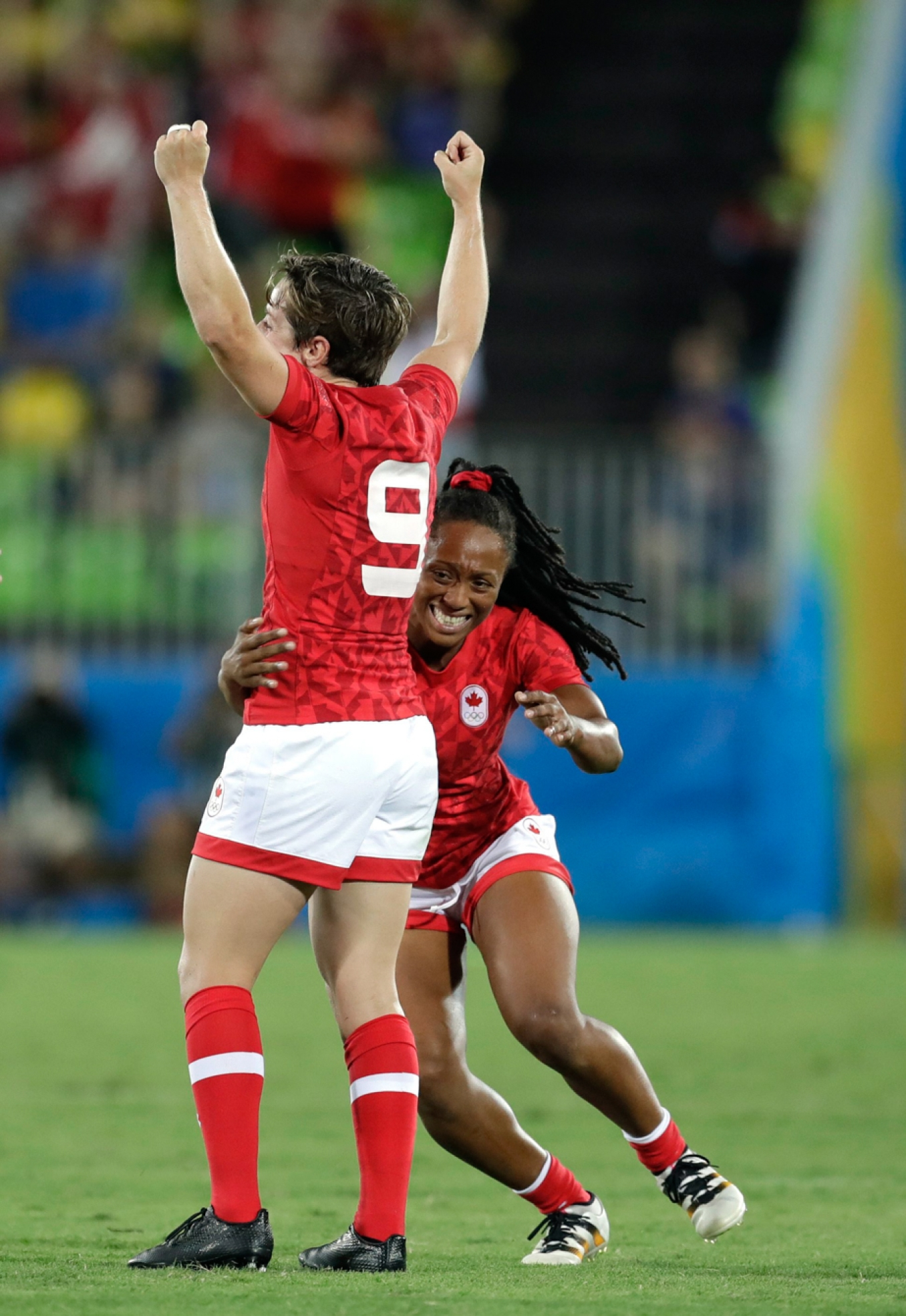 Canada's Charity Williams, right, celebrates with teammate Ghislaine Landry, after winning the the women's rugby sevens bronze medal match against Great Britain at the Summer Olympics in Rio de Janeiro, Brazil, Monday, Aug. 8, 2016. (AP Photo/Themba Hadebe)