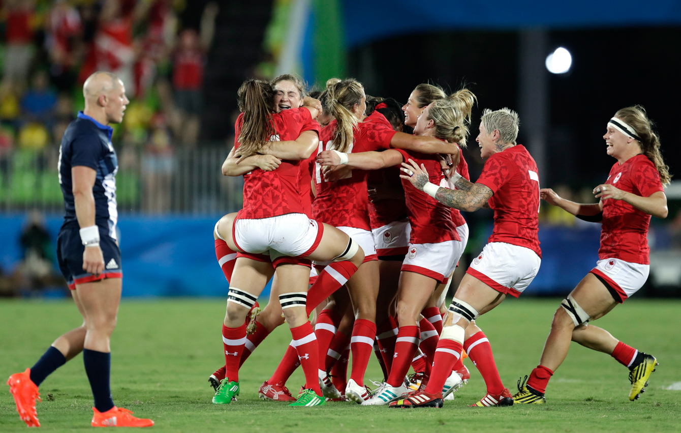 Canada's players celebrates after winning the women's rugby sevens bronze medal match against Great Britain at the Summer Olympics in Rio de Janeiro, Brazil, Monday, Aug. 8, 2016. (AP Photo/Themba Hadebe)
