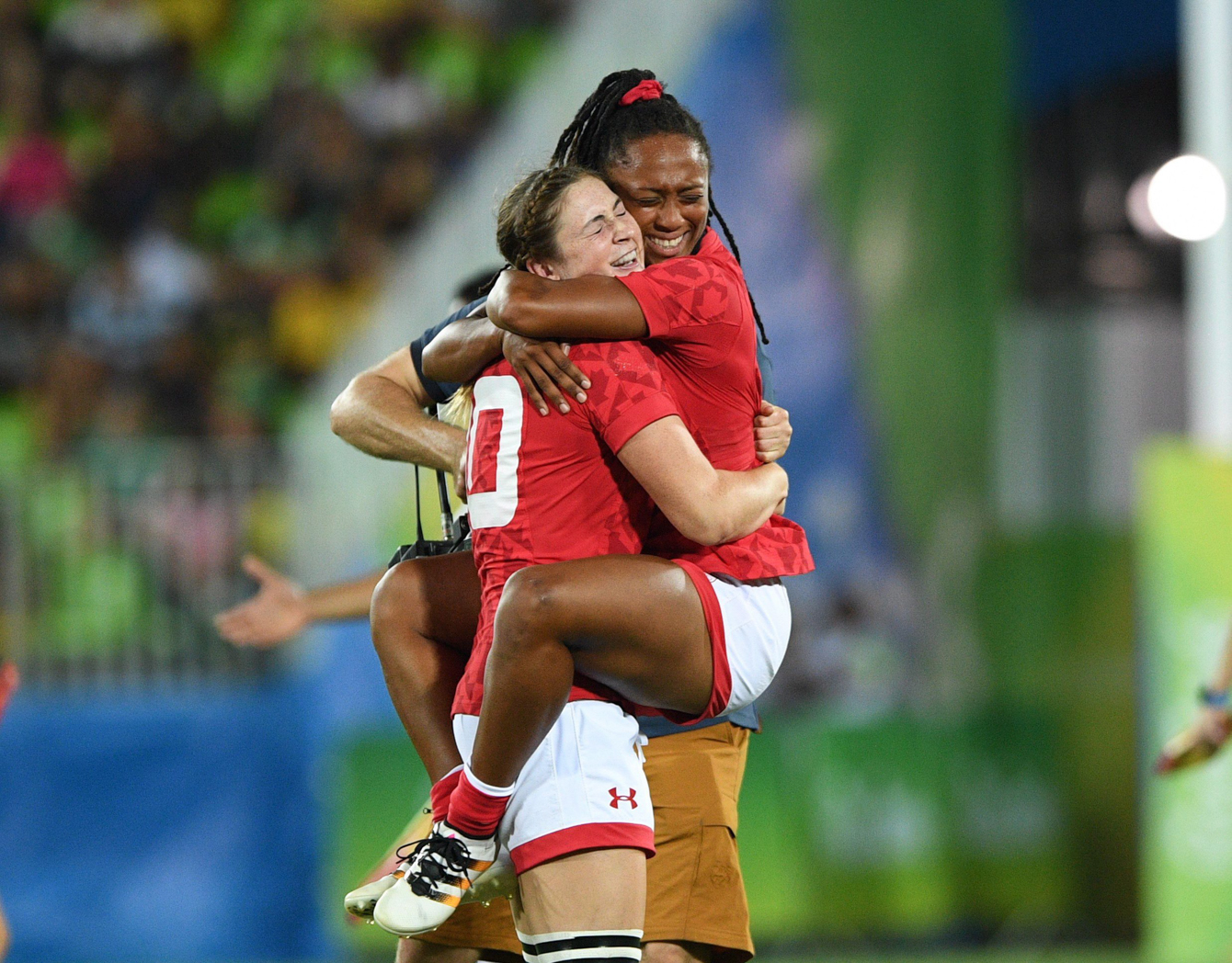 Canada's Charity Williams, right, jumps into the arms of Hannah Darling as they win bronze defeating Great Britain's in women's rugby sevens at the 2016 Olympic Summer Games in Rio de Janeiro, Brazil on Monday, Aug. 8, 2016. THE CANADIAN PRESS/Sean Kilpatrick