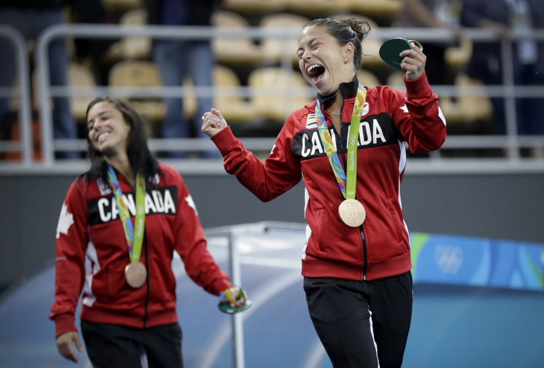 Pair cheering with Olympic medals